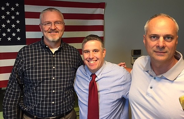 """Rob Woodall and Dave Johnston from Arconic, formally Alcoa with Jeno Berta on """"QC Veterans' Roll Call"""" radio show."""