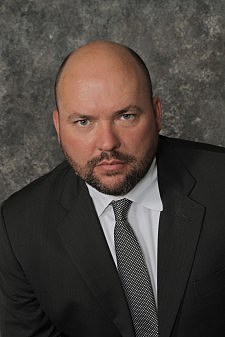 """Army Major (Ret) Thomas Hurley, military criminal defense attorney appearing on """"OC Veterans' Roll Call"""" radio show."""