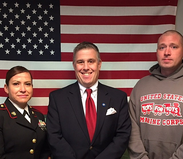 "U.S. Marine Staff Sergeants Alice Ramos and Carl Pedder appearing on ""QC Veterans' Roll Call"" radio show with host Jeno Berta."