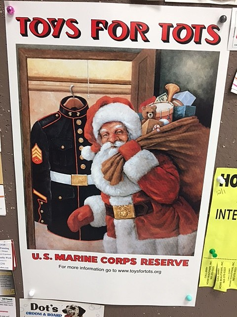 "One of the many ""Toys For Tots"" posters present in our community."
