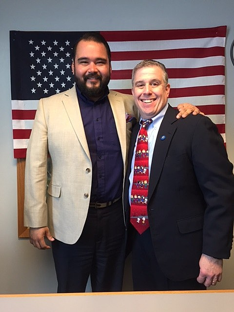 Greg Aguilar, Director, Talent Attraction & Retention with the Quad City Chamber with Jeno Berta taping QC Veterans' Roll Call.